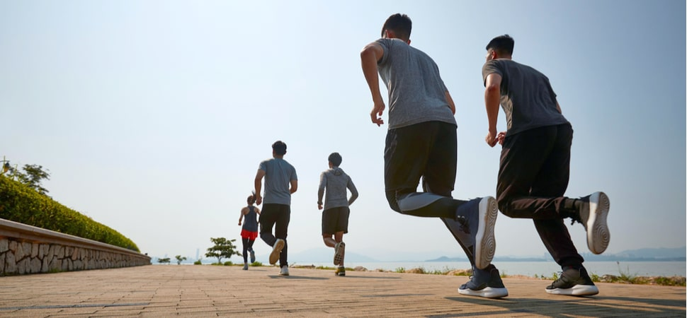 group of men and women running outdoors