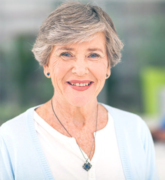 Healthy woman with grey hair smiling